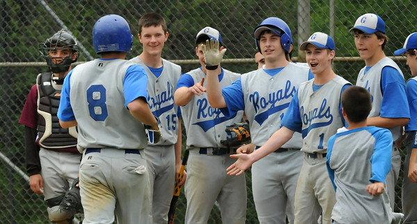 Georgetown: The Georgetown baseball team congratulates teammate Anthony Conte after hitting a homerun against Rockport.  Bryan Eaton/Staff Photo  Newburyport News  Thursday May 14, 2009.