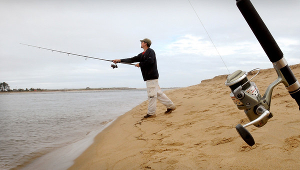 Newburyport: Jeff Gower, pictured, and friend Jeff Gallardo, both of Westford fish the Merrimack River from the shores of Plum Island. Bryan Eaton/Staff Photo  Newburyport News  Friday May 29, 2009.