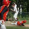 Newburyport: Amesbury's James Paradis heads to first base as teammate Steve Serwon slides under Newburyport shortstop Joe Clancy. Bryan Eaton/Staff Photo Newburyport News Tuesday May 19, 2009.