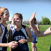 Byfield: Triton's Nicole Rodgers, Tori Clay and Vanessa Short celebrate their running in the 400 yard hurdles. Bryan Eaton/Staff Photo Newburyport News Tuesday May 19, 2009.
