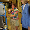 Amesbury: Dressed in Hawaiian garb Dee Cote, PTA treasurer, doles out a frozen pina colada, without the rum, to Amesbury Elementary School teacher Sheila Harney on Thursday. The PTA held Teacher Appreciation Day, and along with help from parents cooked up some Polyesian-themed food for them. Bryan Eaton/Staff Photo  Newburyport News  Thursday May 7, 2009.