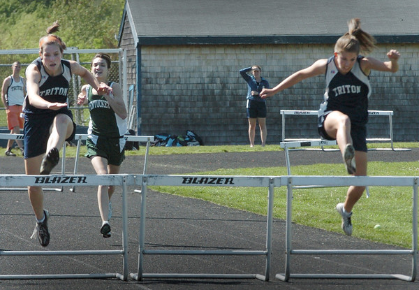 Byfield: Triton's Tori Clay, right, wins the 400 yard hurdles, with teammates Nicole Rodgers, left, and Vanessa Short, out of view, and Pentucket's Hannah Friedstein, center. Bryan Eaton/Staff Photo Newburyport News Tuesday May 19, 2009.