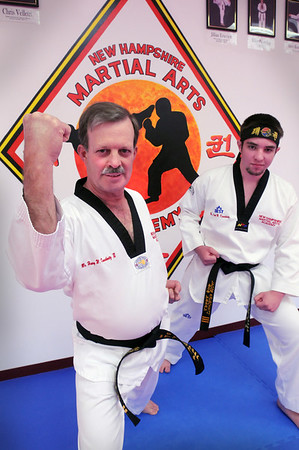 Exeter: Henry Kruschwitz, right, and his son, Jacob, from Merrimac practice  every Tuesday and Thursday at  New Hampshire Martial Arts Academy in Exeter. Bryan Eaton/Staff Photo  Newburyport News  Friday May 29, 2009.