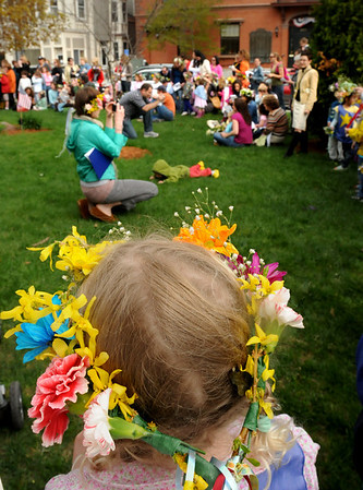 Newburyport: Young heads were covered with spring flowers at the Newburyport Montessori School did their annual celebration of May Day starting in Brown Square. They then headed into upstairs at city hall as the strong winds and rain threatened. Bryan Eaton/Staff Photo  Newburyport News  Friday May 1, 2009.