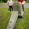 Newburyport: Ghlee Woodworth looks over damage to one of several tombstones tipped over at Oak Hill Cemetery with Peter Consigli of Newburyport Monument. Bryan Eaton/Staff Photo  Newburyport News   Monday  May 18, 2009.