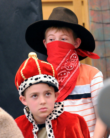 "Salisbury: Jared Cepiel, 7, front, as the King, and Max MacKenzie, 8, Evil McKnievel watch the dress rehearsal of the short play ""The Legend of Slappy Hopper"" at Salisbury Elementary School, the two being in other plays. Students in Bethany Marshall's second grade class are putting on several Tall Tales to present to parents on Friday. Bryan Eaton/Staff Photo  Newburyport News  Wednesday May 13, 2009."