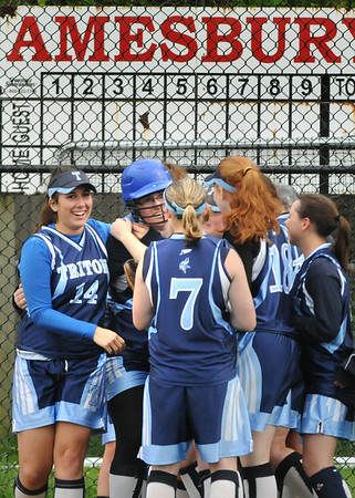 Amesbury: Triton softball players embrace Mikaela Strangie, with helmet, after hitting a two-run homer against Amesbury bringing the Vikings up 5-3 which was the final score.  Bryan Eaton/Staff Photo  Newburyport News  Thursday May 14, 2009.