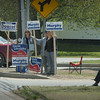 Salisbury: Campaign workers hold signs outside the Hilton Center in Salisbury during voting hours yesterday. Bryan Eaton/Staff Photo Newburyport News  Tuesday May 12, 2009.