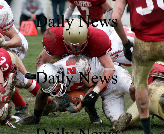 Newburyport: Newburyports Dean Cataldo (56) smothers Amesbury running back Jesse Burrell (26) during the teams annual Thanksgiving Day football game. Newburyport shut out the Indians 33-0. Photo by Ben Laing/Staff Photo