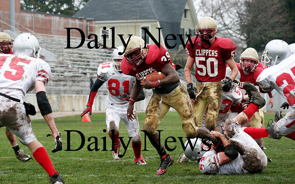 Newburyport: Josh Williams (39) runs over Amesbury's James Pelkey (54) as Newburyport hosted the Indians in the annual Thanksgiving Day game. Newburyport shut out the Indians 33-0. Photo by Ben Laing/Staff Photo