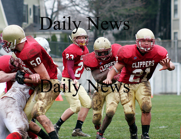 Newburyport: Josh Williams (39) follows his blockers through the hole as the Newburyport hosted Amesbury in the annual Thanksgiving Day football game. Newburyport shut out the Indians 33-0. Photo by Ben Laing/Staff Photo