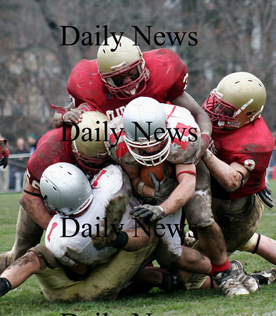 Newburyport: A quartet of Clippers bring down Amesbury running back Jake Conant (14) as Newburyport hosted their rivals in their annual Thanksgiving Day football game. Newburyport shut out the Indians 33-0. Photo by Ben Laing/Staff Photo