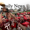 Newburyport: Captians Derek Freeman (37) and Shea Quill (50) hoist the Chase Trophy after defeating Amesbury 33-0 on Thanksgiving Day. Photo by Ben Laing/Staff Photo