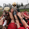 Newburyport: Newburyport hoists the Chase Trophy after defeating Amesbury 33-0 on Thanksgiving Day. Photo by Ben Laing/Staff Photo