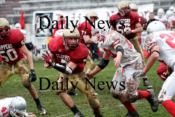 Newburyport: Kyle LeBlanc (7) tries to evade the pursuit by Amesbury's Ian McLaughlin (24) as the Clippers hosted their rivals in their annual Thanksgiving Day football game. Newburyport shut out the Indians 33-0. Photo by Ben Laing/Staff Photo