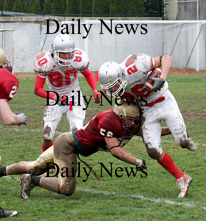 Newburyport: Newburyport's Dean Cataldo (56) tackles Jesse Burrell (26) on a kickoff return during the annual Thanksgiving Day game with Amesbury. Newburyport shut out the Indians 33-0. Photo by Ben Laing/Staff Photo