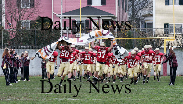 Newburyport: The Clippers take the field to prior to this year's annual Thanksgiving day game against Amesbury. Newburyport shut out the Indians 33-0. Photo by Ben Laing/Staff Photo