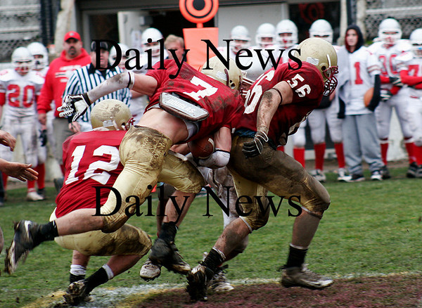 Newburyport: Kyle LeBlanc (7) follows the lead block of Dean Cataldo (56) as Newburyport hosted Amesbury in the annual Thanksgiving Day game. Newburyport shut out the Indians 33-0. Photo by Ben Laing/Staff Photo
