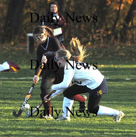 Lynnfield: Newburyport's Paige Hefferan fights for the ball with Lynnfield's Devon MacEachern during their game at Lynnfield Friday. Jim Vaiknoras/Staff photo