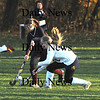 Lynnfield: Newburyport's Paige Hefferan fights for the ball with Lynnfield's Devon MacEachern during their game at Lynnfield Friday. Jim Vaiknoras/Staff photo