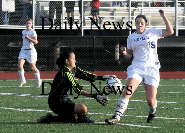 Lynn: Georgetown's Emma Cannon  fights for the ball with Lowell Tech's goalie Amanda Pang during the North Sectional final at the Manning Bowl in Lynn Sunday. Jim Vaiknoras/Staff photo