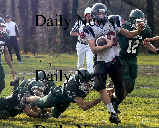 West Newbury:  North Andover's Brandon Walsh breaks into the open field  Sunday at Pentucket. Jim Vaiknoras/Staff photo