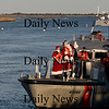 Newburyport: Santa and Mrs Claus arrive in Newburyport courtesy of the US Coast Guard for the Annual parade and Tree Lighting. Jim Vaiknoras/Staff photo