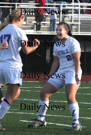 Lynn: Georgetown's Kelly Chickering (2) and Nicoline Holland celebrate a first half goal against Lowell Tech. Jim Vaiknoras/Staff photo