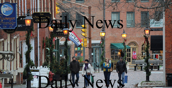 Newburyport: Downtown Newburyport is begining to look a lot like Christmas a week before Thanksgiving, with it's lampposts along Inn Street covered in garland and holiday ights up in many storefronts. Jim Vaiknoras/Staff photo