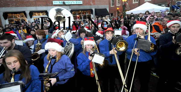 Newburyport: The Triton high school band performs at  the annual Newburyport Parade and Tree Lighting Sunday night in Market Square. Jim Vaiknoras/Staff photo