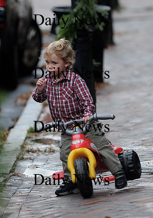 Newburyport: Jacob Decosta, 2, of Amesbury, takes a break from riding his plastic tricycle down Liberty Street in Newburyport to enjoy a lolipop Friday afternoon. Jim Vaiknoras/Staff photo