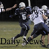 Byfield: Triton's Derek Paquette looks for yardage against Wilmington Friday night at Triton. Jim Vaiknoras/Staff photo