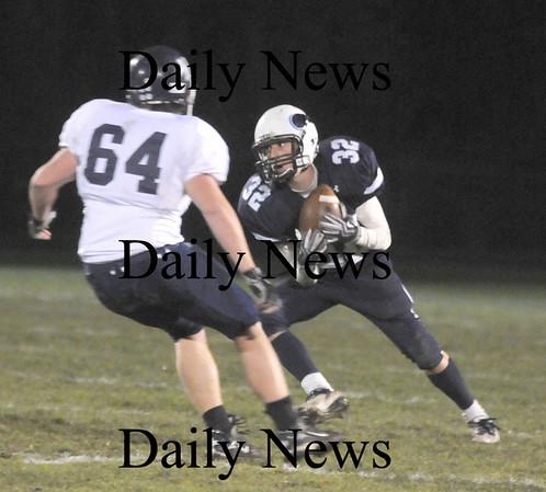 Byfield: Triton's Matt Pearson lheads up field against Wilmington Friday night at Triton. Jim Vaiknoras/Staff photo