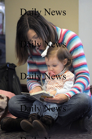 """Newburyport: Sofia Lusardi, 19 months, of Newburyport reads """" Spot Counts From 1 to 10' with her mom Elizabeth while visiting the Newburyport Library. Jim Vaiknoras/Staff photo"""