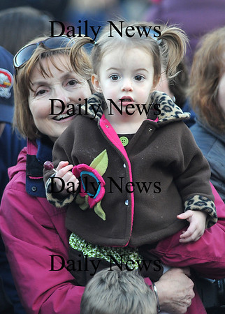 Newburyport: TSheila Trieff holds her granddaughter Sadie Rose Reardon, 2, as she watches Santa go by at  the annual Newburyport Parade and Tree Lighting Sunday night in Market Square. Jim Vaiknoras/Staff photo