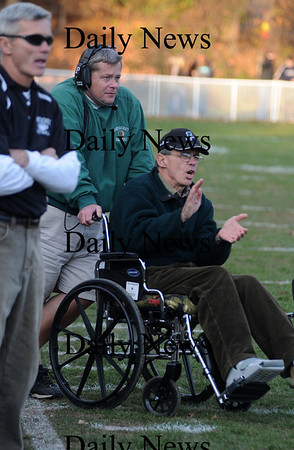 West Newbury: Pentcuket's assitant coach Chris Perry, who was injured last summer at his home, cheers the Sachems on against Mascomonet Saturday at Pentucket. Jim Vaiknoras/Staff photo
