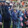 Amesbury: Veterans, police officers, and scouts bow their heads during taps at the Veteran's Day ceremony at the Amesbury Middle School Wednesday. Jim Vaiknoras/Staff photo