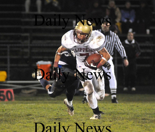 Byfield: Newburyport's Kyle LeBlanc can't escape from Triton's Mike Foley on a punt return during the Clippers game against Triton in Byfield Friday night. Jim  Vaiknoras/Staff photo