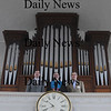 Newburyport: Lark Madden, pastor Harold Babcock and Music Director Jay Lane with the Unitarian church's 1834 pipe organ, which is going to be restored next year. Church is currently raising the funds for the project.Jim Vaiknoras/Staff photo