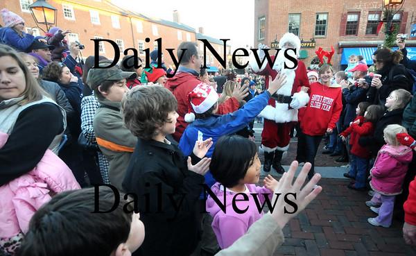 Newburyport: Santa waves to the crowd at  the annual Newburyport Parade and Tree Lighting Sunday night in Market Square. Jim Vaiknoras/Staff photo
