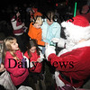 Salisbury: Santa greets and gives out candy canes to kids at the Annual Tree Lighting in Salisbury Square Sunday night. Jim Vaiknoras/Staff photo