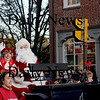 Newburyport: Santa and Mrs Claus wave to the crowd at  the annual Newburyport Parade and Tree Lighting Sunday night in Market Square. Jim Vaiknoras/Staff photo