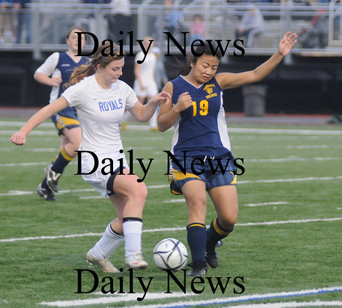 Lynn: Georgetown's Nicole DiMarco fights for the ball with Lowell Tech's Sokthear San during the North Sectional final at the Manning Bowl in Lynn Sunday. Jim Vaiknoras/Staff photo