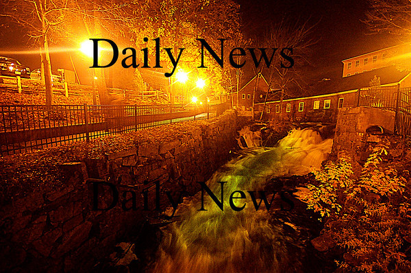 Amesbury: The Powow River ruches through the Mill Yard in Amesbury Sunday night, swelled by this weekends rain and lit only by street lights. Jim Vaiknoras/Staff photo