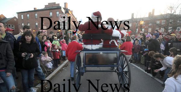 Newburyport: Santa and Mrs Claus wave to the crowd at  the annual Newburyport Parade and Tree Lighting Sunday night in Market Square. Jim Vaiknoras/Staff photo