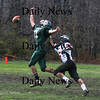 West Newbury: Pentucket's John Modlish can't quite catch up with a pass as he is defended by North Andovers John Hufziger Sunday at Pentucket. Jim Vaiknoras/Staff photo