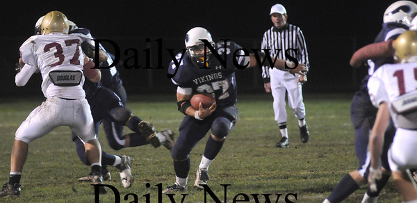 Byfield:Triton's Brendon O'Neil heads up field against Newburyport at Friday nights game in Byfield. Jim Vaiknoras/Staff photo