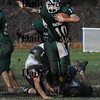 West Newbury: Pentucket's Mike Doud tries to break free from a North Andover tackler  Sunday at Pentucket. Jim Vaiknoras/Staff photo