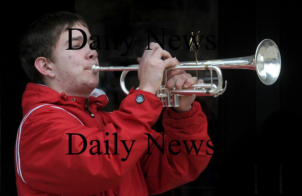 Amesbury: Amesbury high band member Jeff Bucyk plays taps at the annual Veteran's Day service at Amesbury Middle School Wednesday morning. Jim Vaiknoras/Staff photo