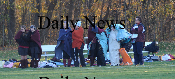 Lynnfield: Members of the Newburyport field hockey team try to stay warm during the Clippers game in Lynnfield Friday afternoon. Jim Vaiknoras/Staff photo